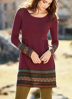 Borrowing its bohemian appeal from Indian kurta styling, the tunic-dress is fine gauge knit of burgundy pima. Masterfully detailed with cross-stitching at the shoulders, pointelle mesh accents and rows of colorful lace and patterned striping at the long cuffs and hem; scalloped trim.