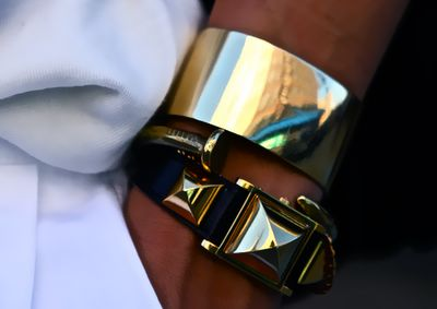 black and gold wristwear