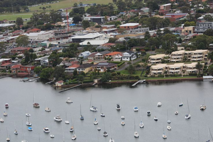 Aerial photograph of Belmont NSW, The Melvic Centre (formerly Melvic Theatre) is the large white building top left hand side opposite the crane. Photograph taken February, 2015.