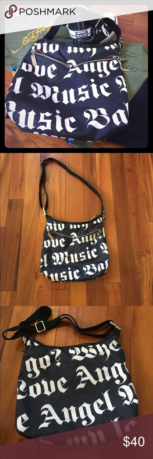 Gwen Stefani LAMB Le Sportsac Black & White Bag! Gorgeous Love, Angel, Music, Baby Gwen Stefani LAMB Bag!  Bought in 2004, this bag is a classic in used but fantastic shape!  Minor wear on the outside, some staining on the inside as shown in photos.  Minor wear on the hardware as seen in pic.  Bag is an easy to wipe Nylon and has an adjustable canvas strap.  Great bag for casual but cool on the go looks!  Bag measure 13L x 11H x 3.5W.  Shown styled with Ed Hardy tee and Banana Republic Jeans…