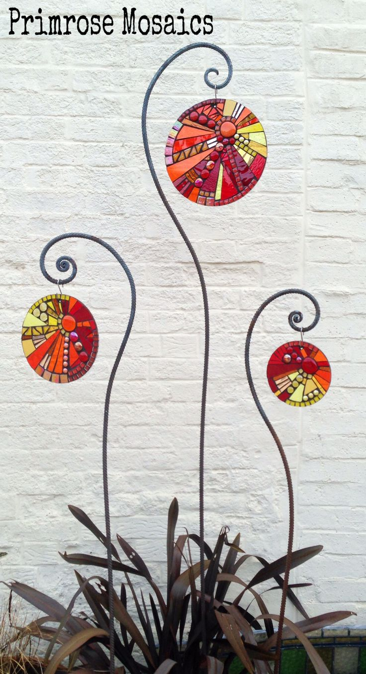 Art for the garden. Hanging trio glass mosaic sculpture. Sunburst design sun-catchers. Handcrafted gifts for gardeners. www.primrosemosaics.com