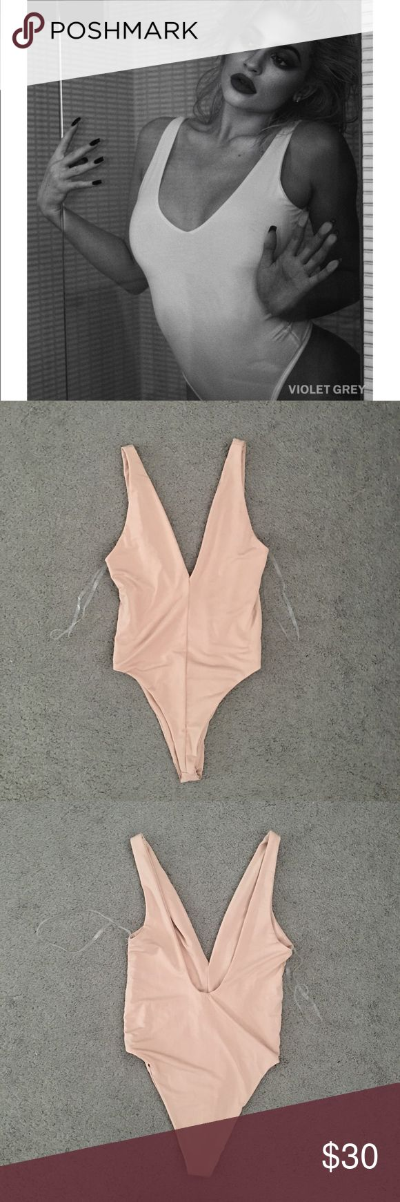 Naked Wardrobe Nude Bodysuit Bikini Brand new with tags. Plunging neckline and a low back. Thong style. Meant to be worn as a bikini but u can also wear it like a bodysuit. Similar to the one Kylie Jenner is wearing. Nude color. Size small. Sold out online. naked wardrobe Swim One Pieces