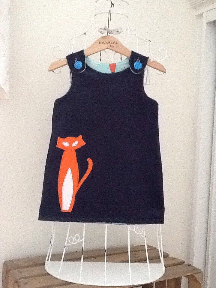 A personal favourite from my Etsy shop https://www.etsy.com/uk/listing/250175838/reversible-dress-girls-pinafore-retro