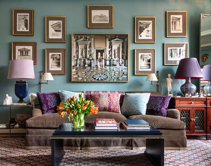 In the family room of alexa hamptons new york city apartment a wall painted a farrow ball blue displays images of architectural elements