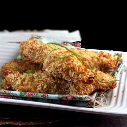 Crunchy Coconut Lime Chicken Strips with Spicy Yogurt Dip.  The crunchiest chicken fingers you'll ever bite into.