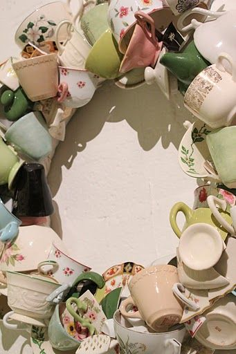 Teacup Wreath.  Better have a sturdy wreath form and a big spot to hang it, but it might be a way to use one of a kind cups etc. from the past that I can't bear to part with.
