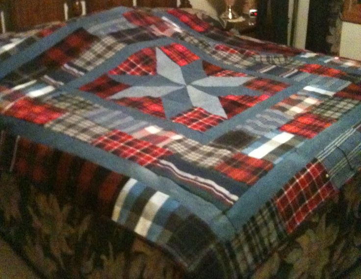 """One of the most awesome ideas ever.... a quilt made out of loved ones clothing.  The embroidered sentiment on border says """"Wrapped in the sweet memories of xxxx xxxxxx"""" <3 <3 <3"""