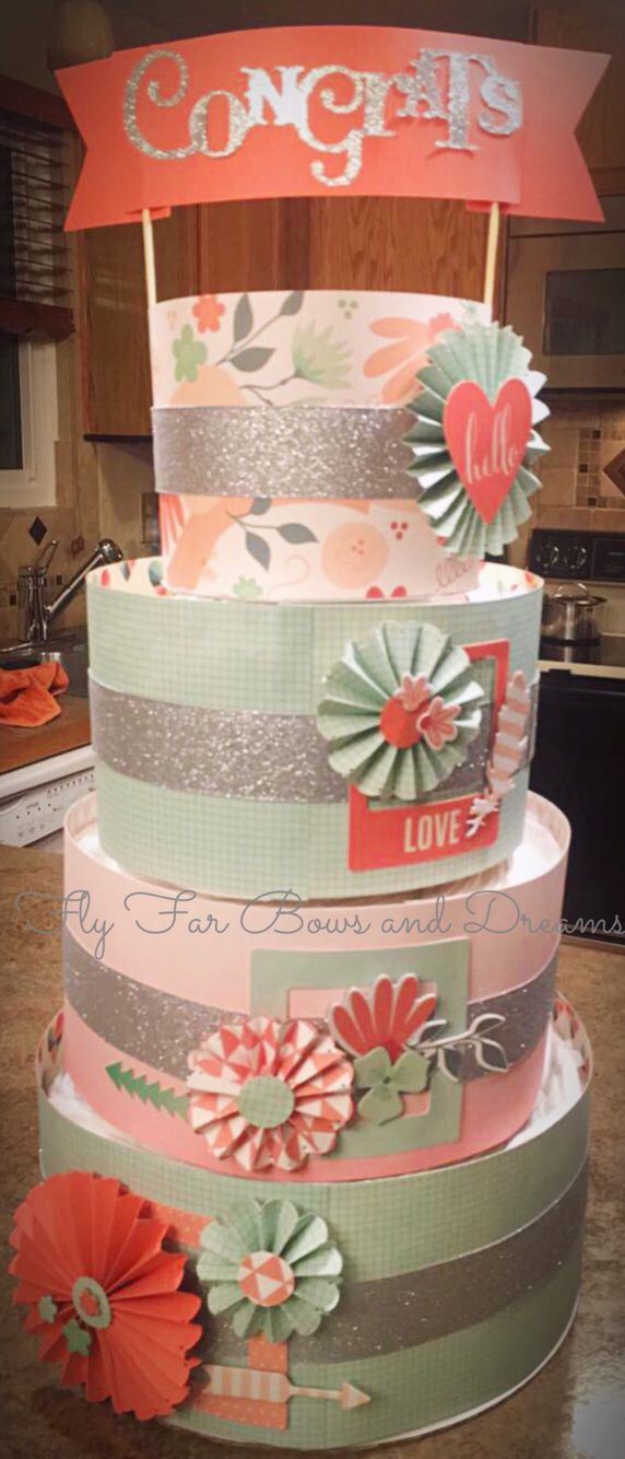 Coral, mint and silver diaper cake for a baby shower that I made.