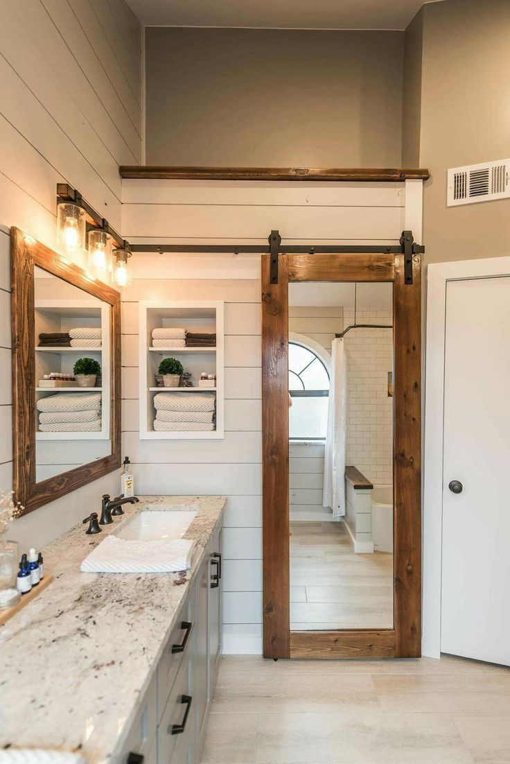 So much dimension was added to this bathroom. Love the concept of a simple sliding door.