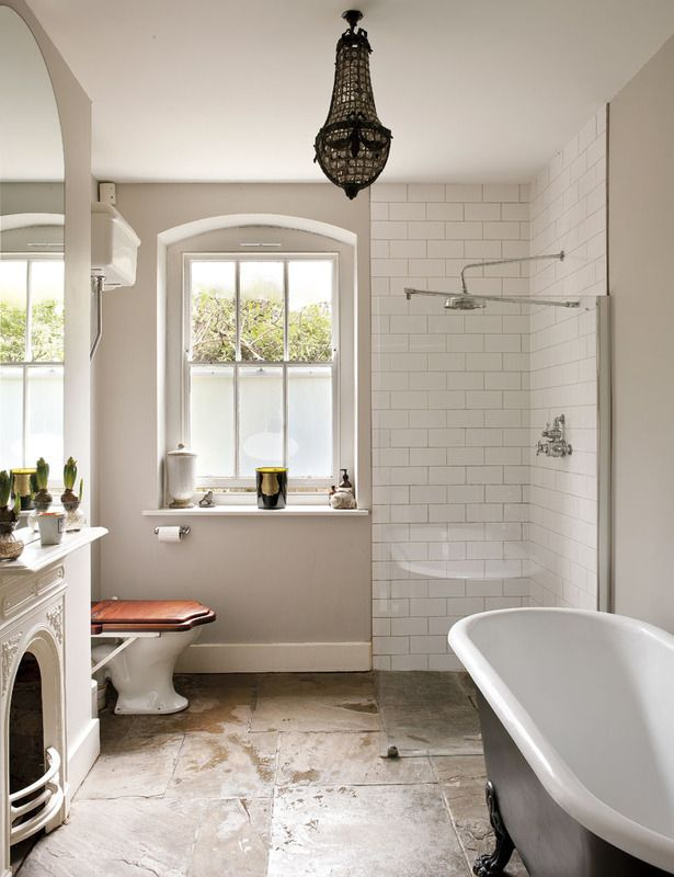 Kept the Victorian feel alive with the clawfoot tub, high tank water closet and fireplace with a hob. Love it.