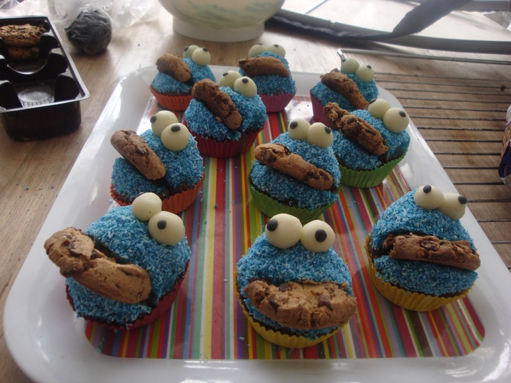 The well known cookiemonsters... cupcakes, blue frosting, blue cocos, chocolatechip cookies and marzipan eyes..