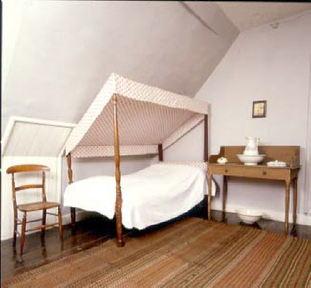 ERDDIG, Wrexham, UK -  Servant's attic bedroom with four-poster bed with tilting canopy