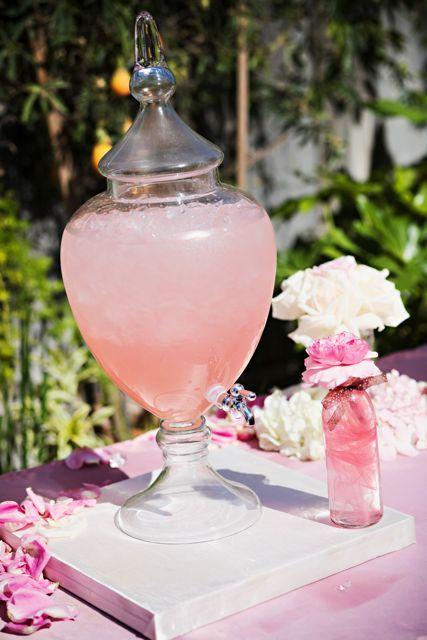 Pink lemonade in glass dispenser