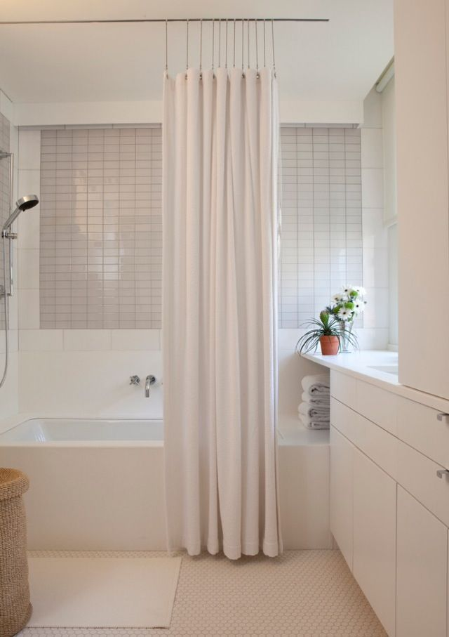 Inspiration Pic for master bathroom. Like how shower curtain is attached to the ceiling so there's no rod. Also, clean and modern looking.