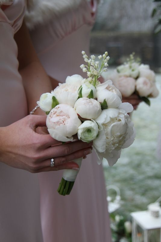 love pale pink peonies + lilly of the valley -- not arranged like this. but these two together are beautiful.