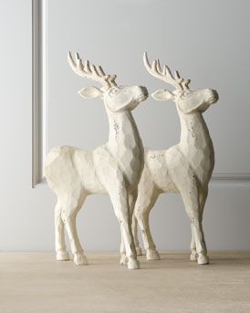 Carved reindeer for decorating a table, mantle, or even a window.