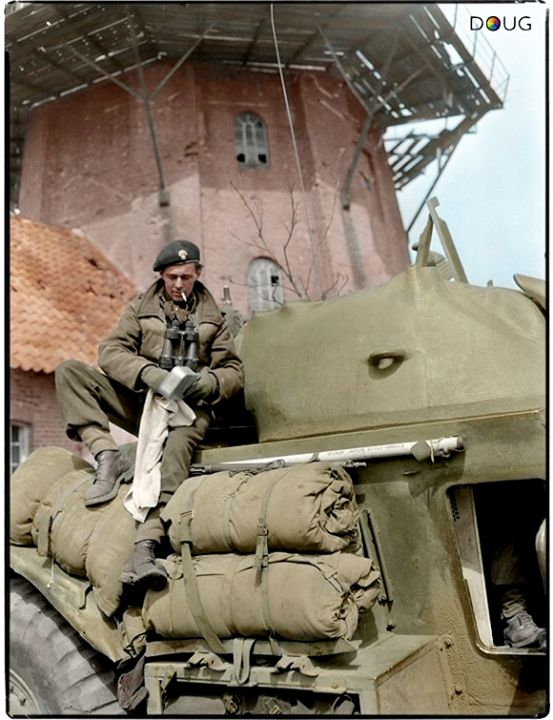 "WW2 Colourised Photos ""Sergeant I.F.Chase cleaning his mess tin on a General Motors T17E1 Staghound armoured car of the South Alberta Regiment, 4th Canadian Division, Bad Zwischenahn, Germany, 29 April 1945 ""  (Lieut. Christopher J. Woods / Canada. Dept. of National Defence / Library and Archives Canada / PA-144148)"