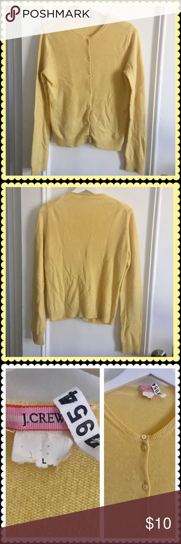 🎁Sale🎁 J. Crew cashmere cardigan. Price firm. J. Crew yellow cashmere cardigan in size L. The label got cut off from dry cleaning tag being attached with staples. So I don't have any proof to put here as its cashmere. Price reflects it. There is a slight discoloration on the back near shoulder as the last photo. Worn and Dry cleaned. J. Crew Sweaters Cardigans