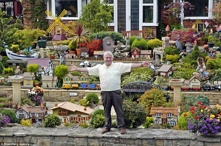 model train layouts | Toot toot! A train lover's dream comes true in his front garden | Mail ...