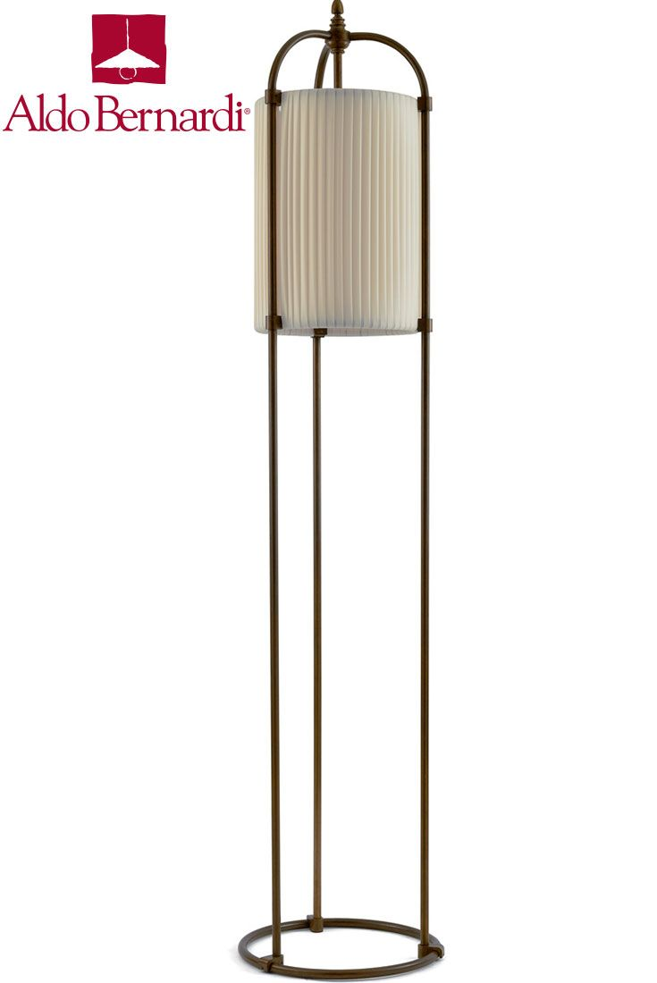 Huà Hikà is a triple stems antique brass mobile lighting fixture on round base with single light and fabric shade fully integrated into structure. Lighting solution by Aldo Bernardi.