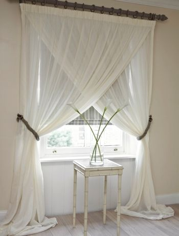 Swap traditional nets for voile- absolutely adore this idea gives it an peaceful elegance feel to the room More