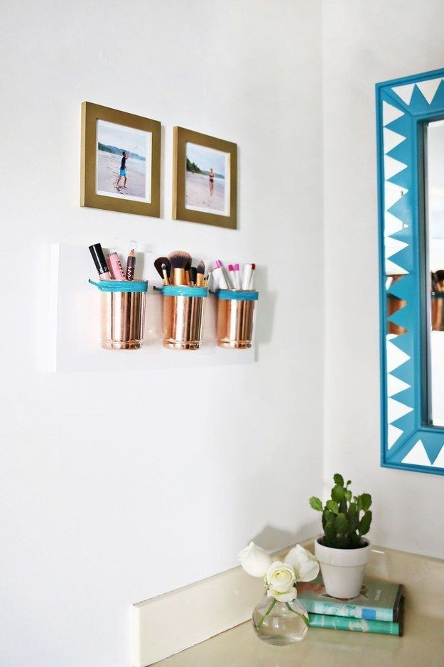 For a tiny bathroom, combine wall decorations with storage by making pretty copper makeup cups. | 31 Cheap Tricks For Making Your Bathroom The Best Room In The House