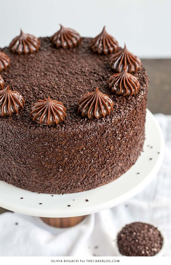 Chocolate Truffle Cake - a chocolate layer cake recipe with dense, moist chocolate cake, silky chocolate truffle frosting and chocolate flakes