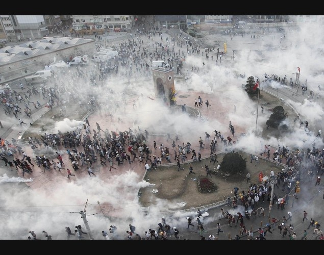 TAKSIM SQUARE IN ISTANBUL, JUNE 13, 2013. Police throw teargas canisters at protesters