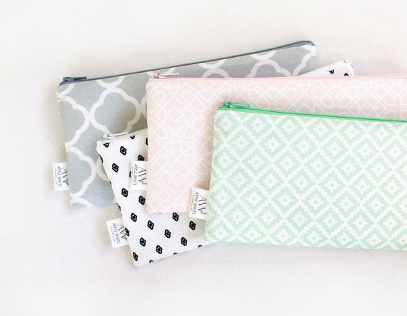 Pastel Patterns Zipper Pouch, Pencil Case, Organizer in fresh modern fabrics. Choose from the colors listed or mix and match a set. Colorful zippers   Use for back pack pouch, make up bag, card holder, travel pouch, organize supplies, diaper bag organizer...anything you can think of!  Quilt weight cotton Lined in cotton fabric.  9 x 4 23 cm x 10 cm  To see my purse, handbag and clutch collection click here: http://www.etsy.com/shop/AppleWhite?section_id=8045111