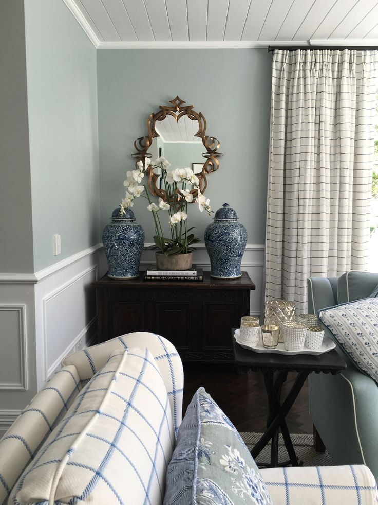 Duck egg blue, navy, white colour scheme, country sunroom with checks, stripes and florals, Schumacher fabric, Sarah Richardson fabric, Barclay Butera fabric, antiques by Melinda Hartwright Interiors