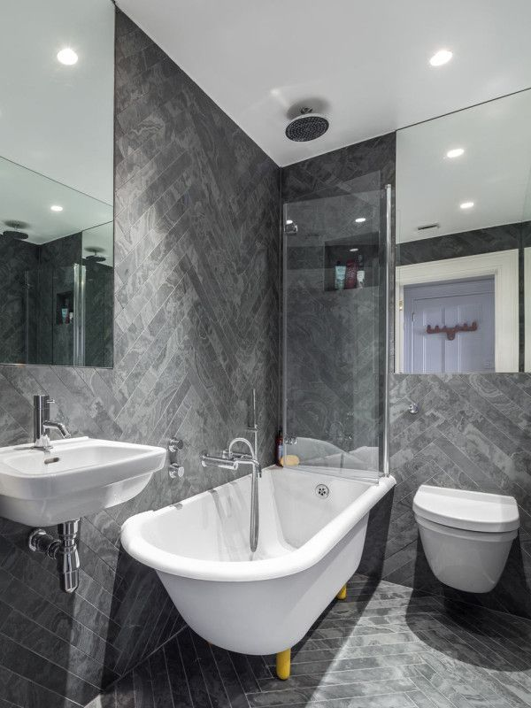 A beautifully designed bathroom this - the wall hung toilet and basin give it an ultra-modern look while the freestanding bathtub really sets it off.