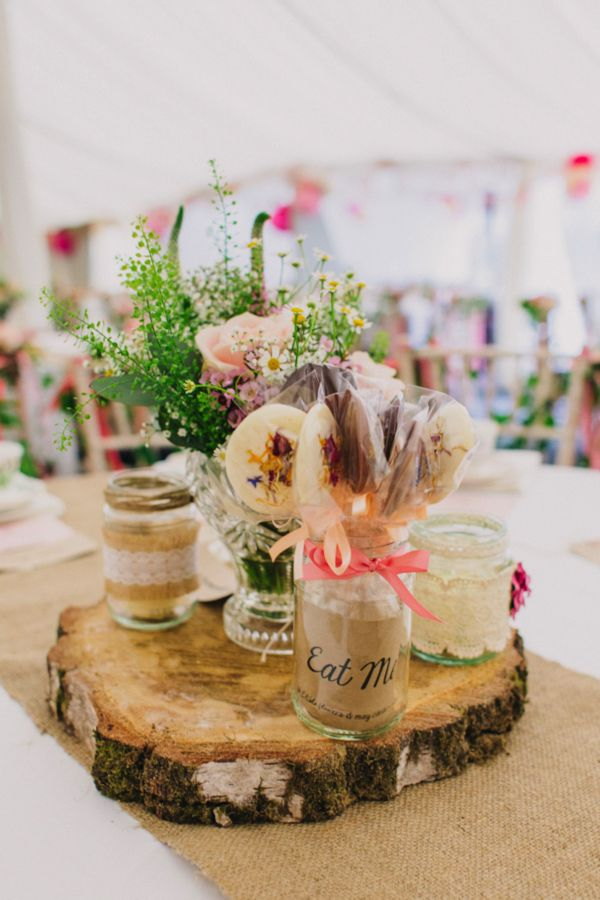 Rustic wedding table centres with real wood and meadow flowers. Peppermint Love Photography