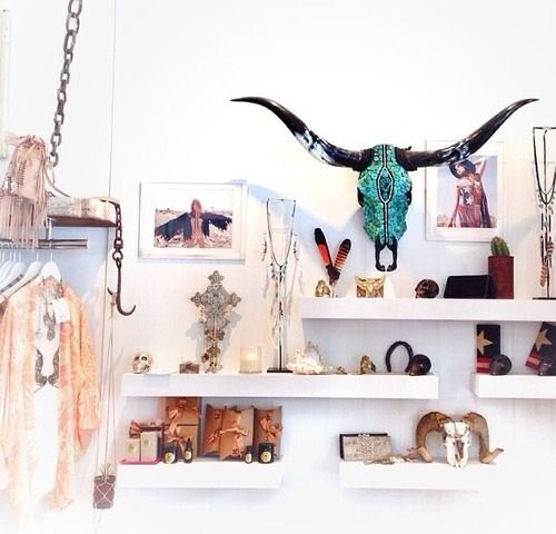 love this cool shop display - clean white shelving