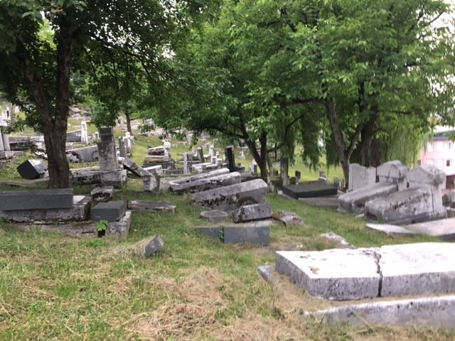 The #Jewish Cemetery in #Sarajevo was used as a hiding place by snipers during the 1990's Bosnian war. They hid on the hill here and shot down into the city. You can still see the scars on the tombstones and can read about it if you click through.