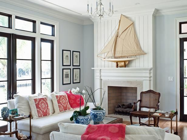 fireplace, pale blue walls and black framing of windows and doors - Colorful Coastal Design on HGTV