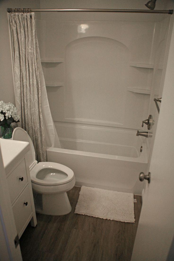 Floors coretec plus xl whittier oak kohler toilet luxury for Luxury vinyl bathroom flooring