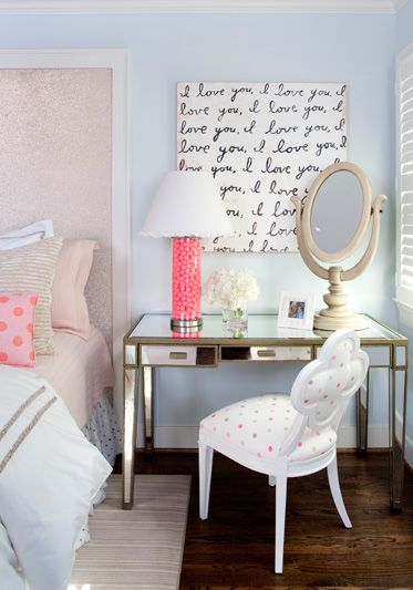 Glamorous pink and blue teen girl's bedroom with tall metallic sheen framed headboard.