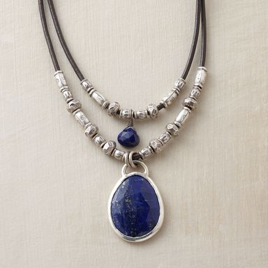 TWOFOLD LAPIS NECKLACE -- Thai silver beads line up along lengths of leather cord, a lapis gem dangling from each. Sterling silver gem settings and toggle clasp. Gem color and shape may vary. Handmade. Exclusive. Approx. 17L.