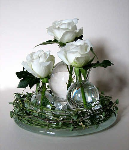Simply single white roses in a vase