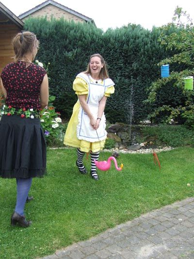 Playing flamingo croquet with a garden flamingo! Can you see how much fun I had?