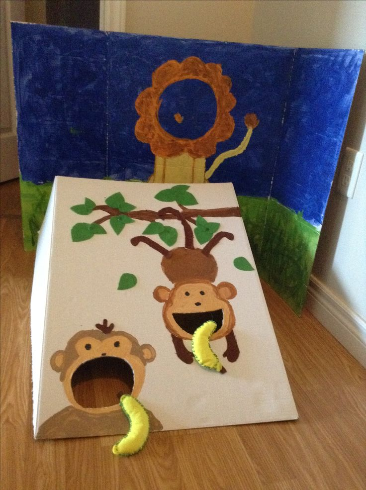 Diy Bean bag game. And lion photobooth in progress... Felt banana bean bag. Birthday party jungle zoo themed.