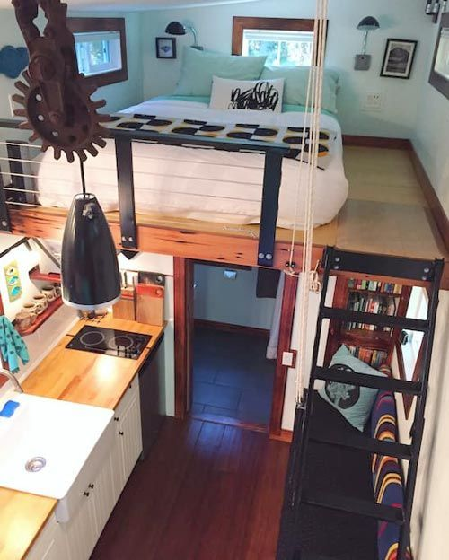This tiny house has a retractable ladder to the bedroom loft.