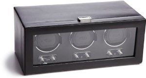 "Wolf Designs 270202 Heritage Module 2.1 Triple Watch Winder with Cover Wolf Designs. $700.00. Dimensions: 14.75""w x 7.50""d x 6.125""h. Patented rotation program: intermittent rotation with pause and sleep phases pre-programmed. Newly designed watch cuff to fit larger, heavier watches. Operates on 3.3V adapter (included) or D-Cell alkaline or lithium batteries.. Black faux leather exterior, chrome clasp closure and control turn knobs with tempered glass cover"