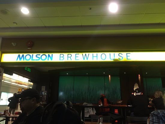 Neon signage over entranceway, Molson Brewhouse Calgary International Airport | 2000 Airport Dr