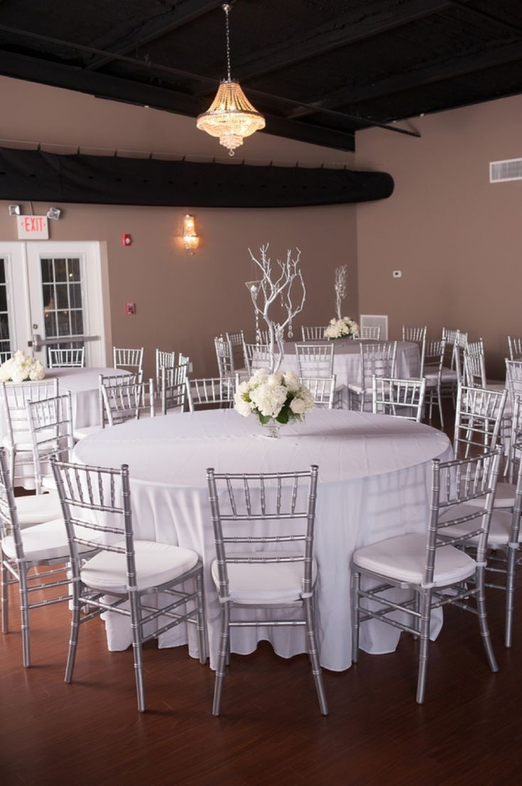 Modern white and silver centerpieces  // photo by Soli Photography