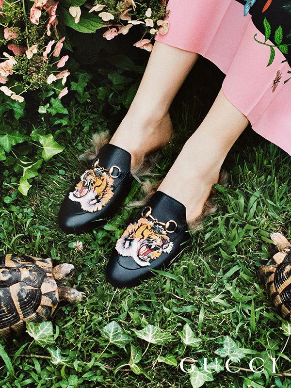 Discover more gifts from the Gucci Garden. Featuring the Horsebit hardware and embroidered tiger patches, the plush Princetown slippers by Alessandro Michele.