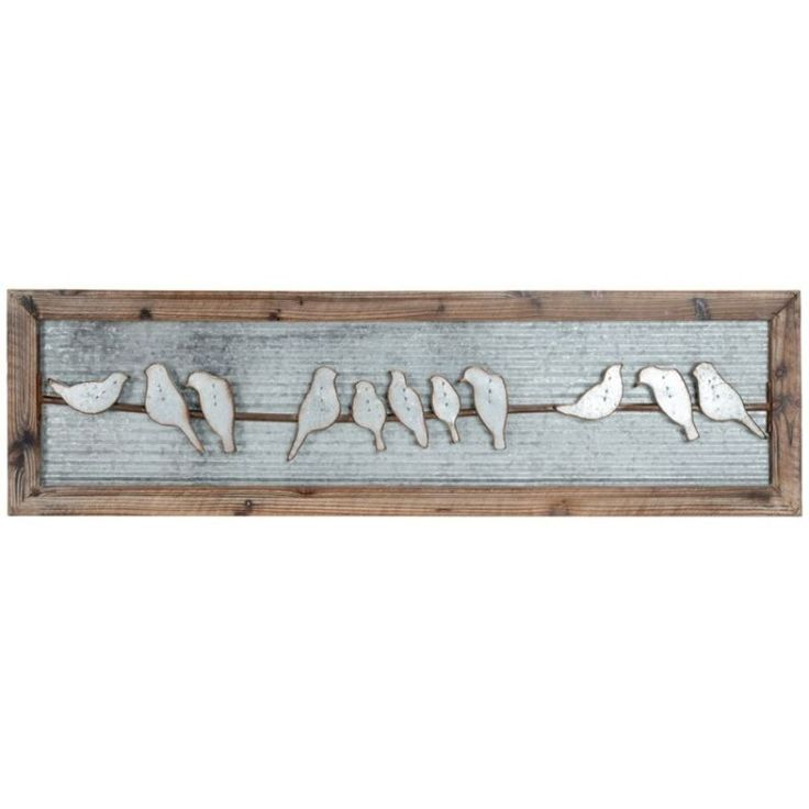 Whether propped above an entryway or sitting on a mantel or bookshelf, this piece of wall art is sure to add beauty and charm to any room, framed in a knotty wood featuring metal birds on a wire with a corrugated metal backing.