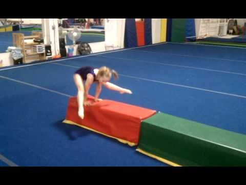 straddle roll on trapezoid to straddle hold  press