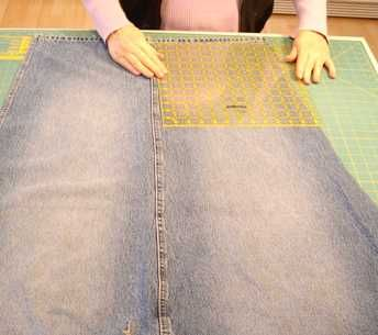 Cutting square for a denim quilt made from old jeans