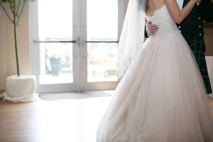 Kleinfeld Canada Newlywed Julia exudes radiance in a blush Danielle Caprese ball gown and beautiful Laura Jayne veil.